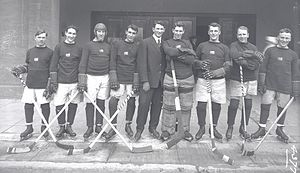 Portland Rosebuds (ice hockey) - 1914–15 Portland Rosebuds. From left to right: Connie Benson, Charles Tobin, Moose Johnson, Smokey Harris, Pete Muldoon, Mike Mitchell, Eddie Oatman, Ran McDonald, Arthur Throop.
