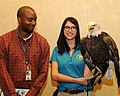 Posing for picture with Bald Eagle. (10596613726).jpg