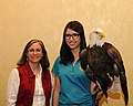 Posing for picture with Bald Eagle. (10596989296).jpg