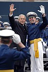 President George W. Bush waves to the crowd with a cadet May 28 at Falcon Stadium during the U.S. Air Force Academy graduation.jpg