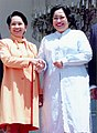 Presidents Gloria Macapagal-Arroyo and Megawati Sukarnoputri beam and shake hands as they meet again.jpg