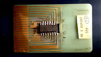 Smart card - One of the first smart-card prototypes, created by its inventor Roland Moreno around 1975. The chip has not yet been miniaturized. On this prototype, one can see how each leg of the microchip (center) is connected to the exterior world by a golden connector.