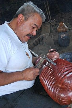 Santa Clara del Cobre - Coppersmith Abdón Punzo in his workshop in Santa Clara