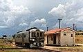 RM 1901 waits under looming skies at Texas station, Queensland, ~1991.jpg