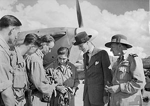 Sir Ronald Cross, 1st Baronet - Sir Ronald Cross, as United Kingdom High Commissioner to Australia, meeting with RAAF personnel, c. 1944.  Cross is second from the right.