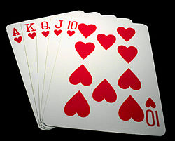 Five playing cards – the ace, king, queen, jack and ten of hearts – spread out in a fan.