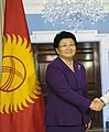 Roza Otunbayeva with Kyrgyzstan flag.jpg