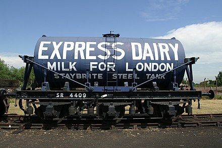 Preserved Express Dairies three-axle milk tank wagon at the Didcot Railway Centre, based on an SR chassis SR 4409 6 Wheeled Milk Wagon Didcot Railway Centre.jpg