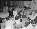 Salinas, California. Evacuees of Japanese ancestry are vaccinated by fellow physician evacuees at a . . . - NARA - 536171.tif