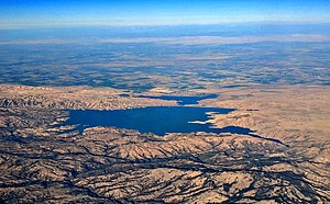 San Luis Reservoir - The San Luis Reservoir and O'Neill Forebay, aerial view from near Hollister, California, with late afternoon shadows outlining the hills of the oak woodlands around it.