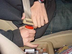 CU, man buckling seatbelt