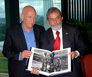 Sebastião Salgado - Salgado (left) gives former Brazilian president Lula da Silva his new book in 2006.