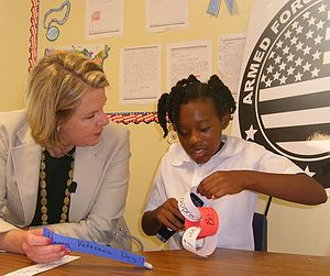 Armed Forces Foundation - Secretary of Education Margaret Spellings with a child during the Armed Forces Foundation's Operation Caring Classroom