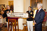 Secretary of the U.S. Navy Ray Mabus, right, the Evening Parade guest of honor, exchanges gifts with Marine Corps Gen. James F. Amos, left, the commandant of the Marine Corps and the host of the Evening Parade 130531-M-KS211-200.jpg