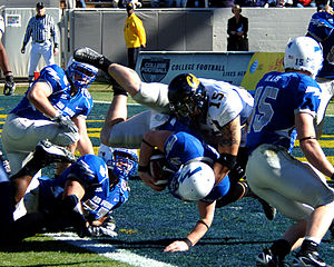 2007 Air Force Falcons football team - Falcons quarterback Shaun Carney falls into the end zone for a first-quarter touchdown.