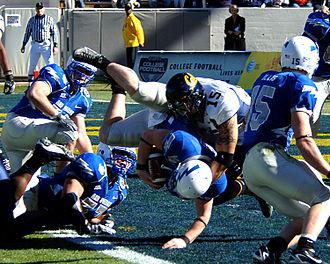 2007 Air Force Falcons football team - Falcons quarterback Shaun Carney falls into the end zone for a first-quarter touchdown.
