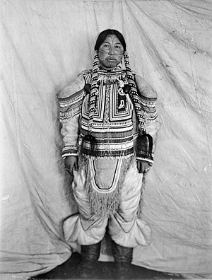 "Inuit art - Niviatsinaq (""Shoofly Comer""), Aivillik Inuit from Cape Fullerton, Nunavut, Canada, son of George Comer, models traditional clothing, 1903–4"