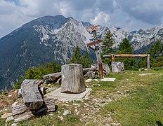 Sign and benches at mountain hut Roblekov Dom, Karawanks, Slovenia.jpg