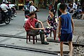 Sitting on railway tracks Hai Phong.jpg