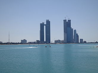 Abu Dhabi - Skyscrapers on West Corniche Rd, Al Ras Al Akhdar, in March 2013. Etihad Towers at the right.