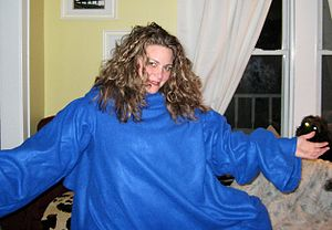 Sleeved blanket - A woman wearing a blue Snuggie