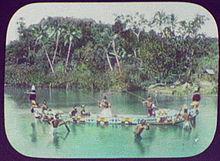 Solomon Island Warriors with Spears in Ornamented War Canoe