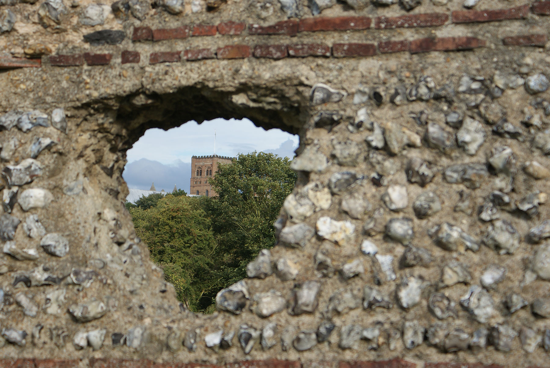 St Albans Cathedral through old Roman wall.jpg
