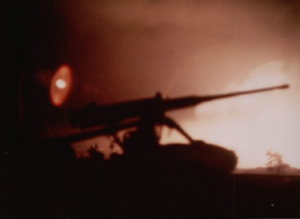Explosive material - Tet Offensive 1968. 12.7mm M2 machine gun at USMC Camp Carroll firing on advancing enemy troops as seen from LZ Betty 15 miles southeast.