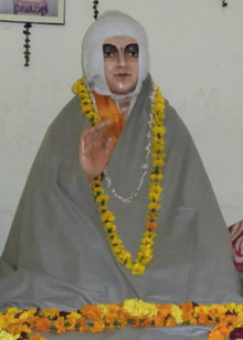 Statue of Jiva Goswami in his tomb in Vrindavan.png