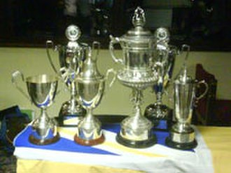 Stocksbridge Park Steels F.C. - The trophies won by the club's first team, reserves and youths in 2006–07.  The Sheffield and Hallamshire Senior Cup is the third trophy from the right.