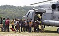 Stranded persons to be taken to a safer place, queuing up for boarding an Indian Air Force (IAF) helicopter following a recent massive earthquake in Nepal.jpg