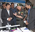 Subhash Ramrao Bhamre getting some inputs from the Chief of Army Staff, General Bipin Rawat while going round an exhibition of Solutions and Innovations.jpg