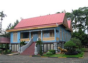 Malay houses - Rumah Lipat Kajang style, a Sumatran Riau Malay traditional house with tiled stairs at Taman Mini Indonesia theme park.