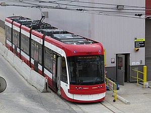 Pantograph (transport) - A Flexity Outlook LRV with its pantograph raised. Note the trolley pole in the rear, which provides compatibility with sections not yet upgraded for pantograph operation.