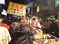 Taiwan Aborigine Roast Pork and Millet Wine Seller in Miaokou Night Market 20120205a.JPG