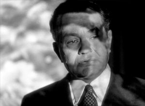 The Stranger (1946 film) - Wilson (Edward G. Robinson) steps into the projected image of the Holocaust footage in The Stranger
