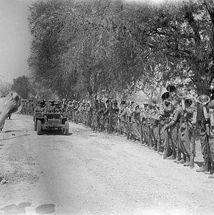 Thomas Wynford Rees - Lieutenant General Sir William Slim and Major General T. W. Rees are cheered by troops as they leave Mandalay in a jeep, March 1945.