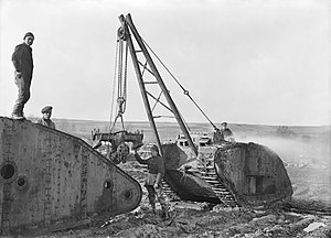 Chinese Labour Corps - Labour Corps men and a British soldier canabalise a wrecked Mark IV tank for spare parts at the central stores of the Tank Corps, Teneur, spring 1918.