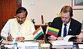 The Minister of State for Culture (Independent Charge), Tourism (Independent Charge) and Civil Aviation, Dr. Mahesh Sharma and the Minister of Culture, Lithuania, Mr. Sarunas Birutis signing an agreement, in New Delhi.jpg