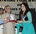 The President, Shri Pranab Mukherjee presenting the Rajat Kamal Award for Best Female Playback Singer Tuhya Dharma Koncha (Marathi) to Ms.Bela Shende, at the 61st National Film Awards function, in New Delhi on May 03, 2014.jpg