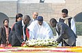The President of Mali, Mr. Amadou Toumani Toure laying wreath, at the Samadhi of Mahatma Gandhi, at Rajghat, in Delhi on January 11, 2012. The Minister of State for Defence, Dr. M.M. Pallam Raju is also seen.jpg