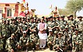 The Union Home Minister, Shri Rajnath Singh in a group photograph with BSF personnel, during his visit to a Border Outpost, in Bikaner, Rajasthan.JPG
