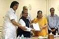 The Union Minister for Mines and Steel, Shri Narendra Singh Tomar handing over the detailed exploration reports of 28 mine blocks to the Chief Minister of Rajasthan, Smt. Vasundhara Raje, in Jaipur on July 16, 2015.jpg