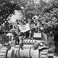 The crew of a Lee tank pose with a captured Japanese flag during the advance south of Mandalay, Burma, 20 March 1945. SE3497.jpg