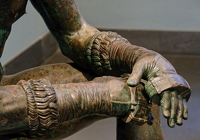 "close-up of oxys from a replica of the Greek sculpture ""Boxer at Rest"" - Greek Boxing Equipment"