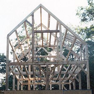 The completed frame of a modern timber-frame house