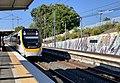Train approaching Corinda railway station, Queensland, 727.jpg