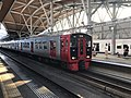 Train for Kokura Station at Hakozaki Station.jpg
