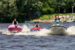 Tubing (recreation) - Towed tubing behind a personal watercraft on the Mississippi River