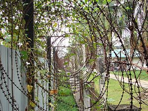 Tuol Sleng Genocide Museum - Razor wire around the perimeter